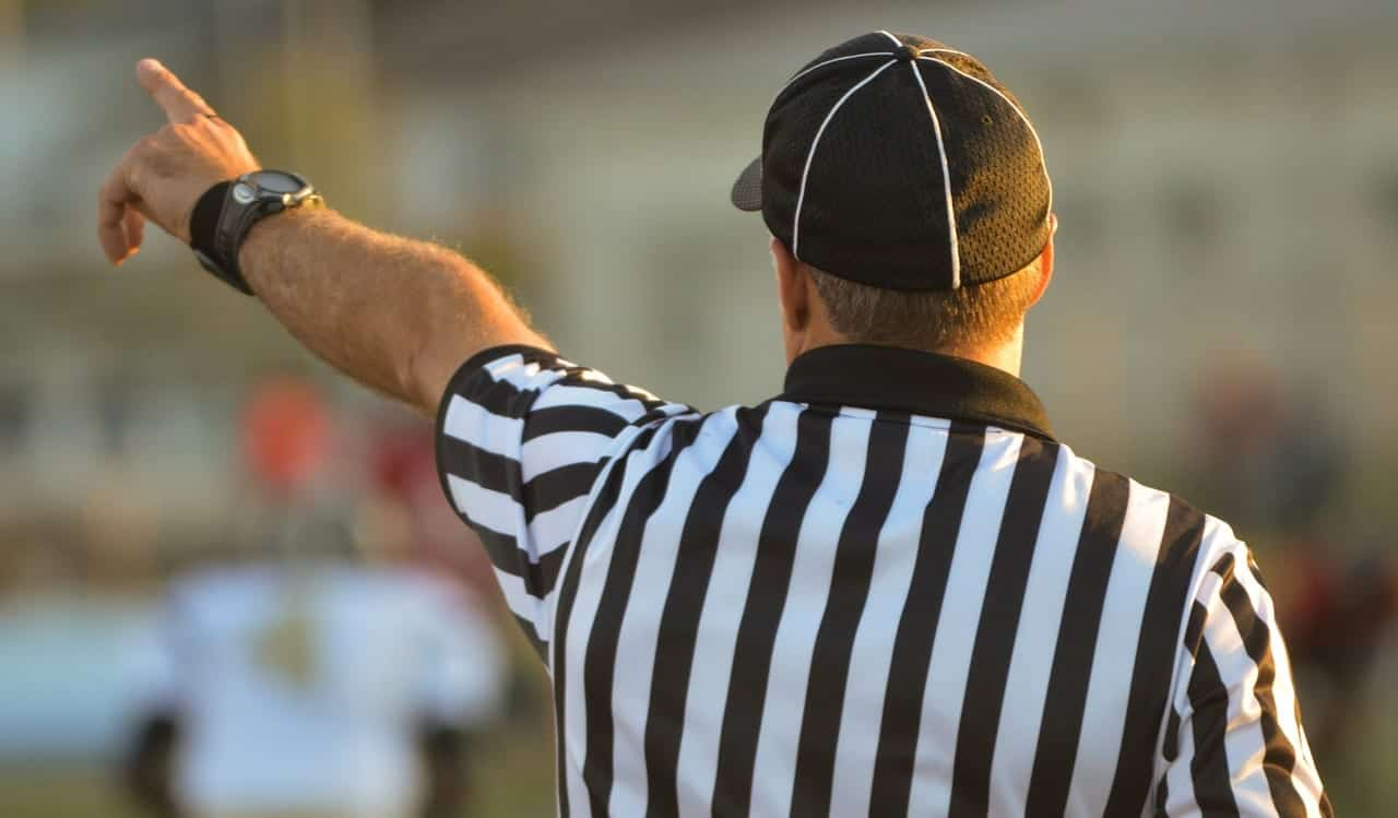 back of referee pointing