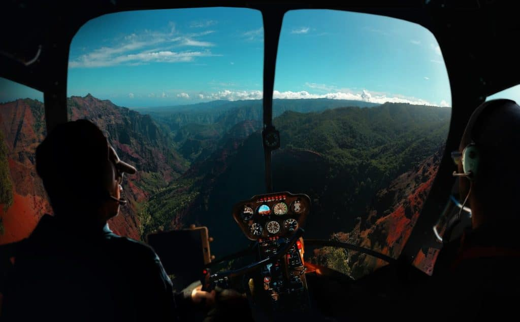 helicopter pilots flying about mountains