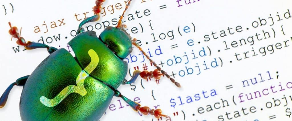 green beetle on top of a code sheet