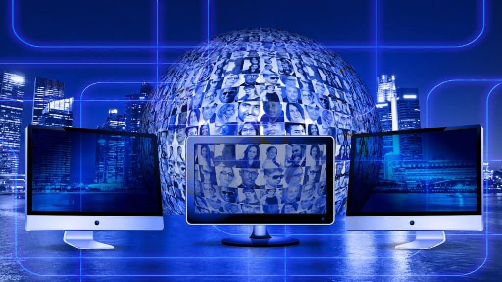 blue image of three monitors in front of sphere with many faces