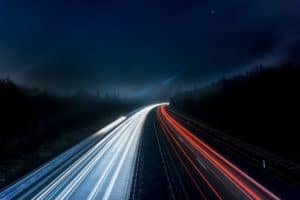 long exposure of night car lights on the road