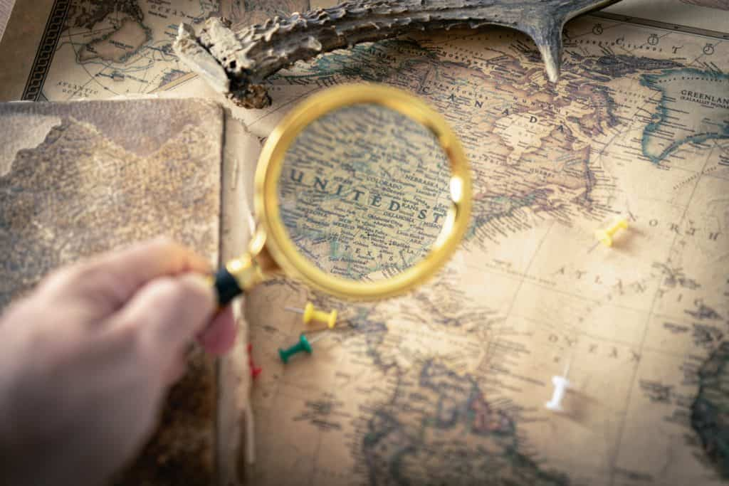 Zooming in on a map with a magnifying lens